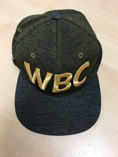 front view of green and grey WBC baseball cap with WBC embroidered in Gold on the front