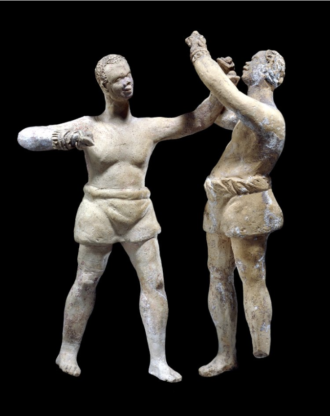 Two terracotta figurines of African boxers from the British Museum Collection.