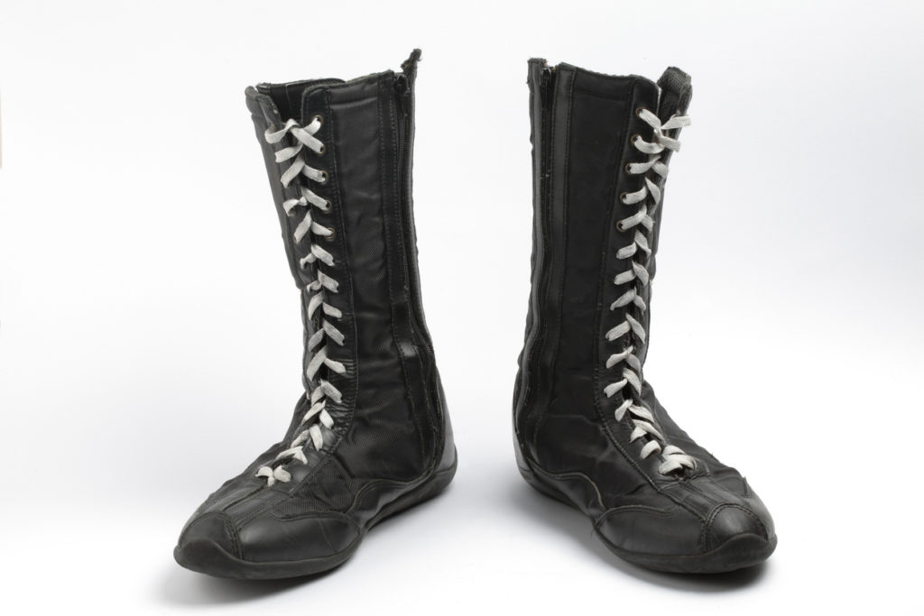 Product shot of a pair of black boxing shoes with white laces