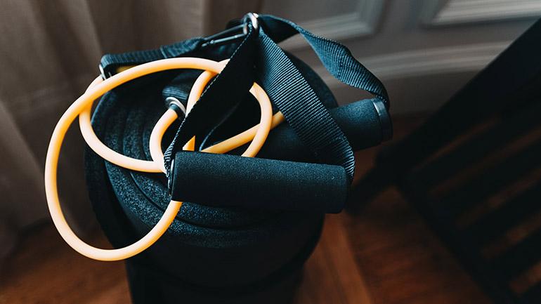 Orange skipping rope with black foam handles