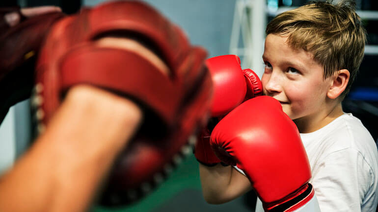 home workout for kids boy with boxing gloves