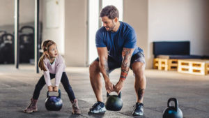 home workout for kids father and daughter with kettle bells