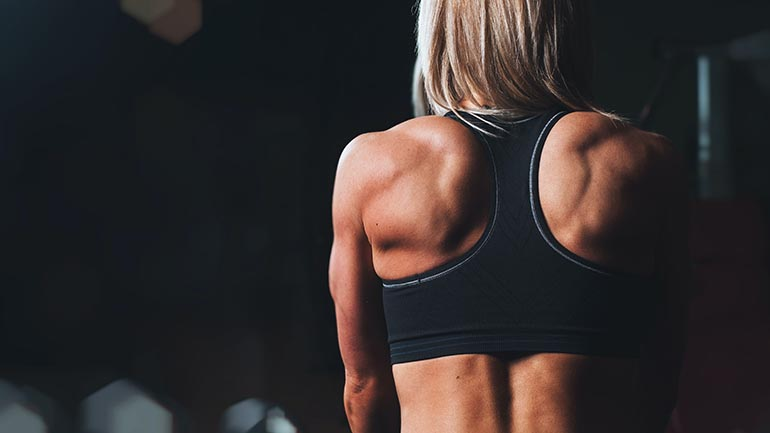 woman with flexed back muscles