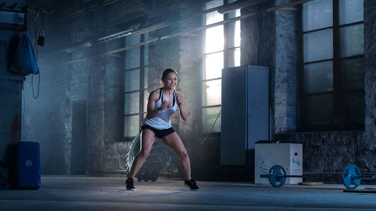 woman lunges to train boxing footwork